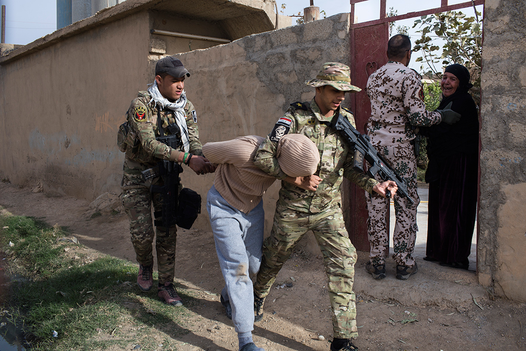 Iraqi military operations in Mosul between 7/11/2016 to 20/12/2016 with the Iraqi ERD forces from southern Mosul in (Hammam Alalil) town and (Gogjali) town East of Mosul.The pictures show the daily life of the ERD fighters on the front lines of the battle, efforts to liberate the areas and villages outside of Mosul, people displaced from Mosul, and night raids. During this period the ERD carried out humanitarian violations including rape, torture, and killing of Iraqi civilians.