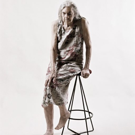 Madje Steber sits on a stool during a portrait session at her daughter's home in 2006.  Madje, a scientist, suffered from memory loss the last 9 years of her life. Still image from the project, Rite of Passage.
