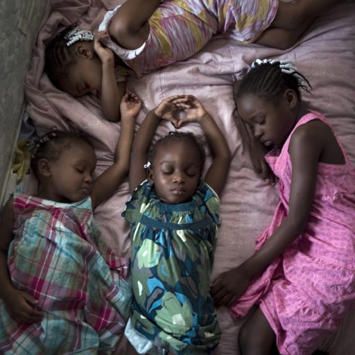 PHOTOS BY MAGGIE STEBERMia Dennis' daughters, ages 3 to 8,  take their nap on Sunday afternoon.  Girls are:  Frederika Wright, 8 (pink dress), Alexis Johnson, 5 (pink/yellow dress), Connie Johnson, 4 (plaid dress) and Amelia Johnson, 3, in middle of photo.  CONTACT:  Mother Mia Dennis: 305-896-6317 or 8317; also grandmother Mary Trody at 786-413-6039 or through photographer Maggie Steber if you have problems contacting them:  305-757-6167