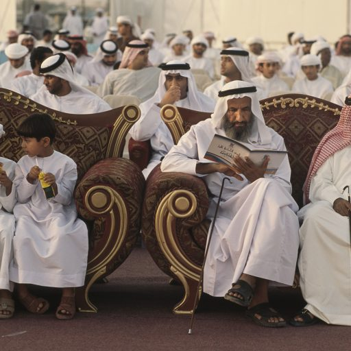 EMIRATI BOYS ENJOY JUICE AT THE SIDE OF THEIR VIP ELDERS DURING A MASS WEDDING CEREMONY IN RAS AL KHAIMAH, AN EMIRATE ABOUT 3 HOURS DRIVE FROM DUBAI, IN THE U.A.E.  THE GOVERNMENT-SPONSORED MASS WEDDING, ATTENDED BY THE GROOMS AND MEN ONLY, IS HELD TO ENCOURAGE AND ASSIST EMIRATIS TO MARRY AND BUILD THE EMIRATI POPULATION.  WEDDINGS COST BIG BUCKS IN U.A.E.  THE WOMEN CELEBRATE IN PRIVATE SEPARATELY.