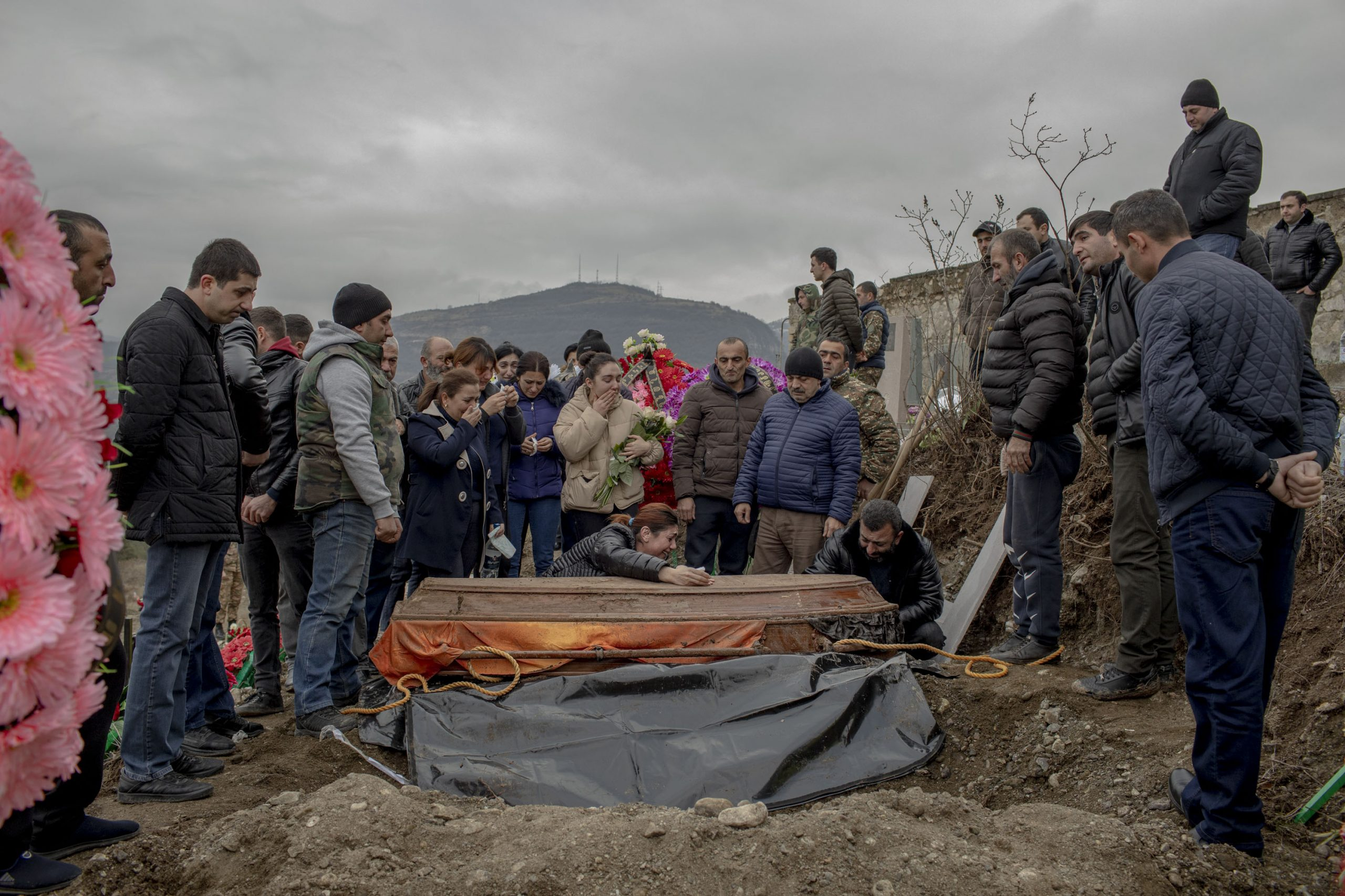 Anush Aleksanyan cries over the coffin that carries her son Erik Hovsepyan, 18, in Stepanakert, Nagorno-Karabakh on December 19, 2020. Erik is buried for the second time, his coffin was transferred from Nagorno-Karabakh's Taghavard village to Stepanakert, as Taghavard came under Azerbaijan's control.