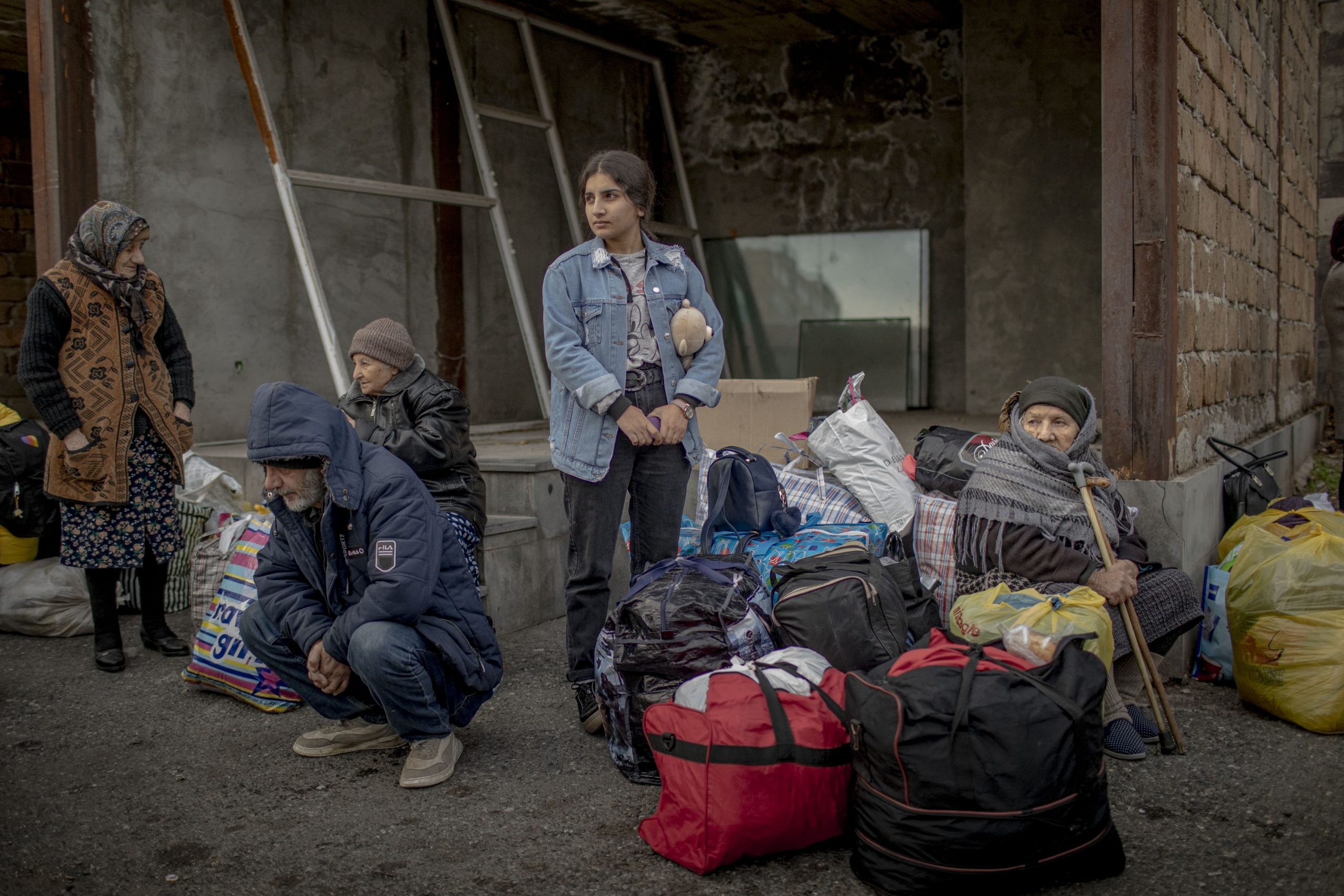 Families from Nagorno-Karabakh wait for busses to Stepanakert, in Yerevan, Armenia, on November 19, 2020. These families found refuge in Armenia during the days of the war and are now returning to their home towns and villages in Nagorno-Karabakh.