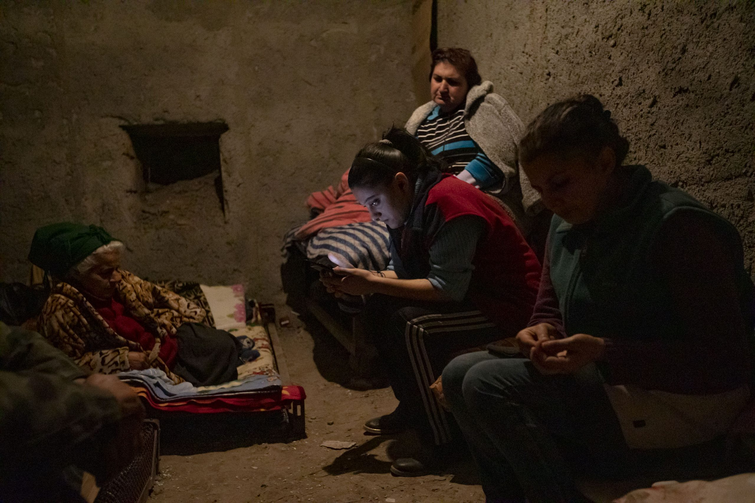 Residents of a five floor building hide in a shelter under their building, in Shushi, Nagorno-Karabakh, on October 16, 2020. The town, which Armenians call Shushi and Azerbaijanis call Shusha, came under Azerbaijan's control by the end of the Nagorno-Karabakh war.