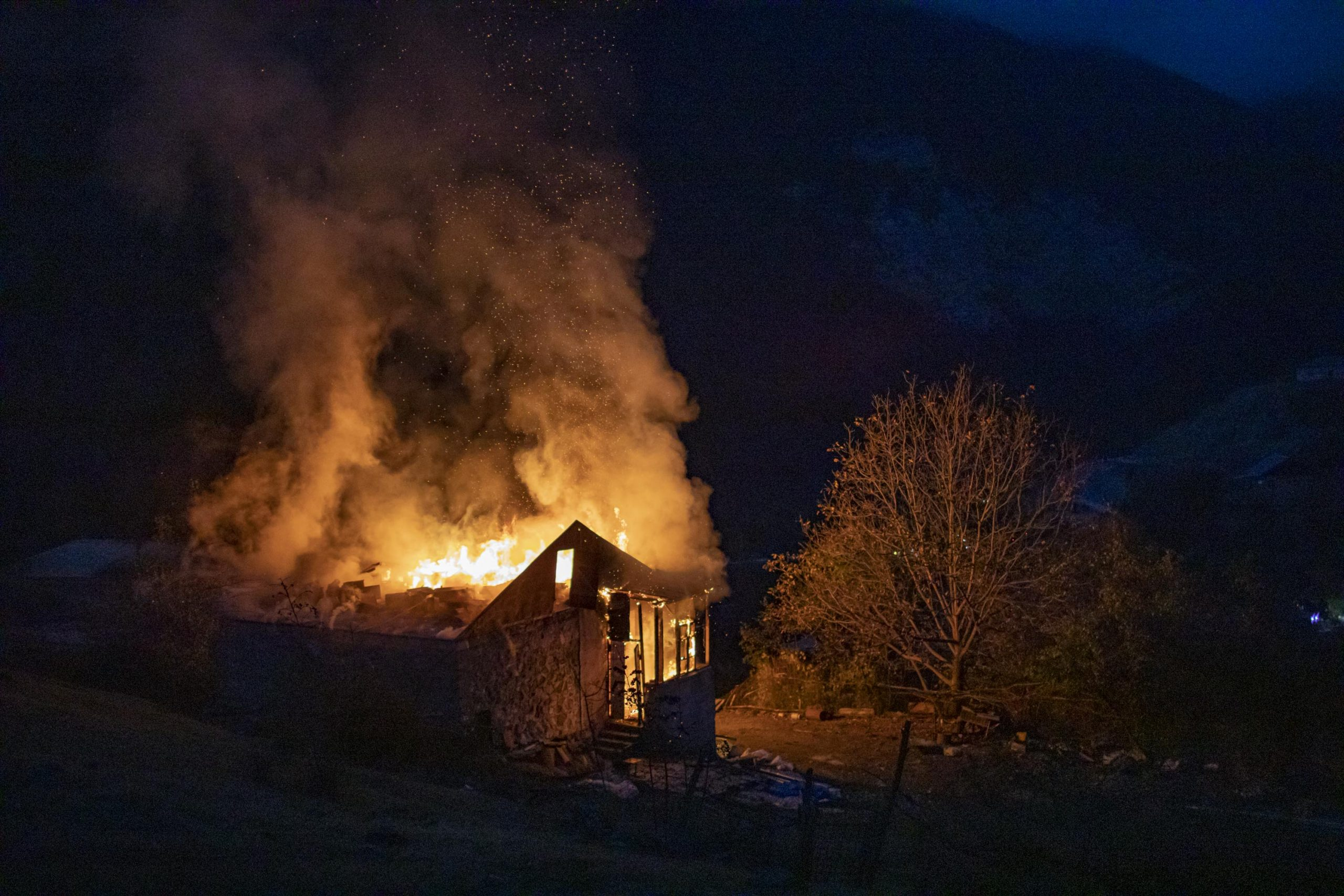 House set on fire by its owners, close to Dadivank Monastery in Kalbajar region, seen on November 14, 2020. Kalbajar is one of the regions surrounding Nagorno-Karabakh, turned over to Azerbaijan as the Nagorno-Karabakh war ended. In numerous cases Armenians burned their houses in this region, in order for them not to be inhabited by people moving here from Azerbaijan.