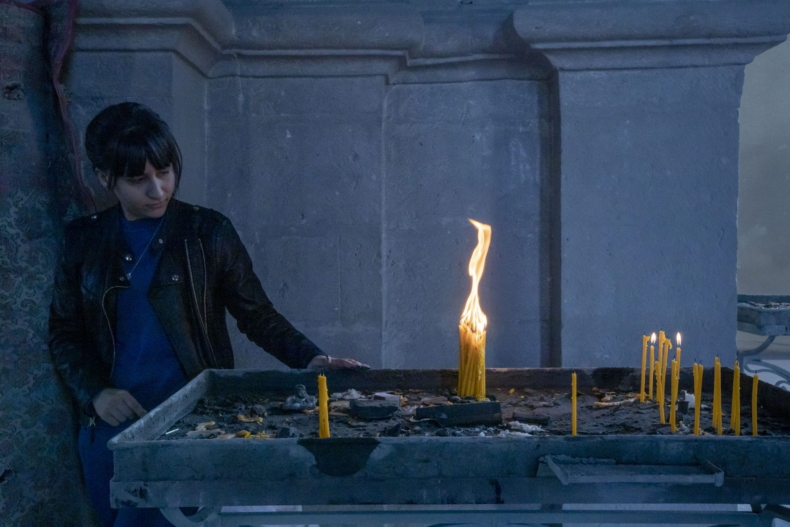A woman looks at 31 candles she has lit for a missing soldier in Ghazanchetsots Cathedral in Shushi, Nagorno-Karabakh, on October 16, 2020. She notes that she lit as many candles as is his age. The cathedral was shelled twice on October 8, 2020. The town, which Armenians call Shushi and Azerbaijanis call Shusha, came under Azerbaijan's control by the end of the Nagorno-Karabakh war.