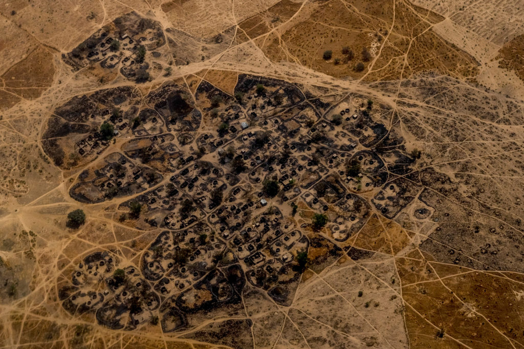 A burned Nigerian village seen from a United Nations helicopter flying between Maiduguri and Monguno. Villages have been razed and burned by both Boko Haram and the Nigerian Military throughout the region. PHOTO BY ASHLEY GILBERTSON / VII.